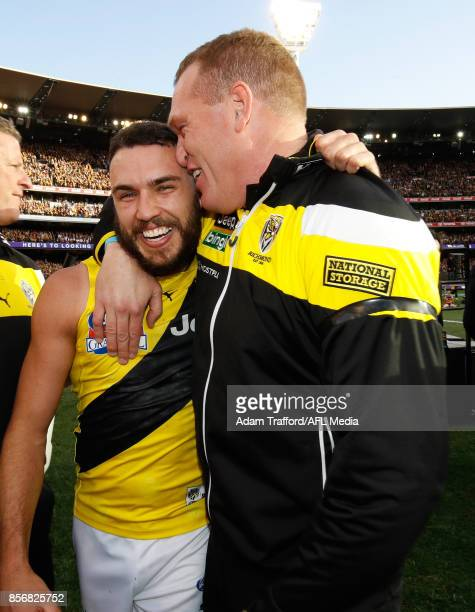 Shane Edwards of the Tigers celebrates with Justin Leppitsch Assistant Coach of the Tigers during the 2017 Toyota AFL Grand Final match between the...
