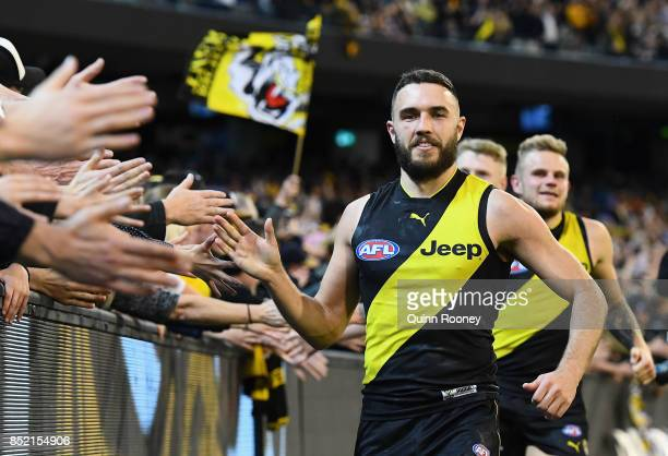 Shane Edwards of the Tigers high fives fans after winning the Second AFL Preliminary Final match between the Richmond Tigers and the Greater Western...