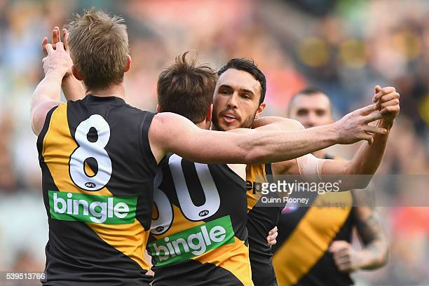 Shane Edwards of the Tigers is congratulated by team mates after kicking a goal during the round 12 AFL match between the Richmond Tigers and the...
