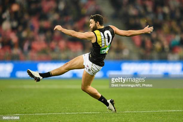 Shane Edwards of the Tigers kicks the ball during the round 17 AFL match between the Greater Western Sydney Giants and the Richmond Tigers at...