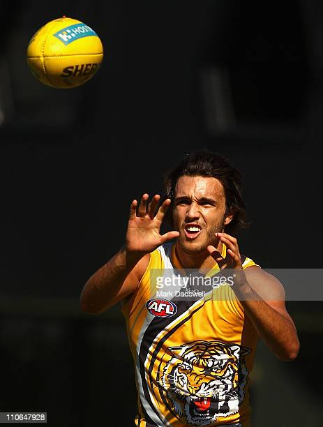 Shane Edwards of the Tigers marks during a Richmond Tigers AFL training session at Punt Road Oval on March 23 2011 in Melbourne Australia