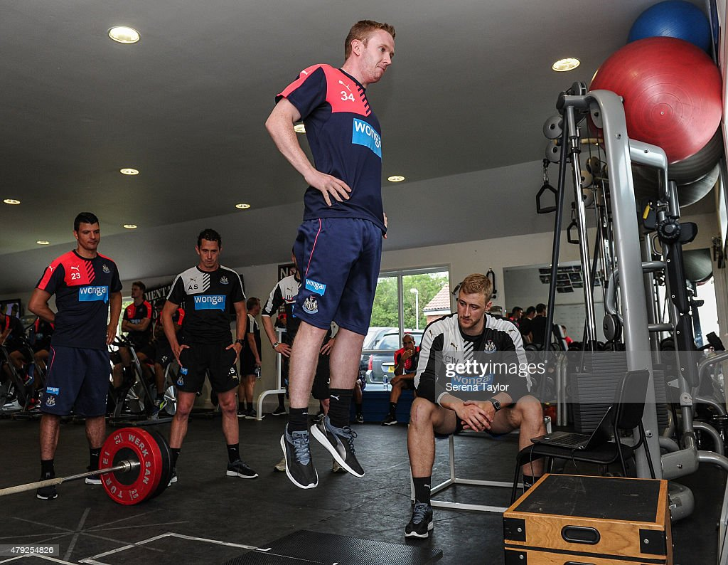 Shane Ferguson undertakes a fitness test whilst Strength and Conditioning Coach Chris Wilding (R) and Fitness Coach Alessandro Schoenmaker (2nd from left) watch on during the Newcastle United Pre-Season Training session at The Newcastle United Training Centre on July 1, 2015, in Newcastle upon Tyne, England.
