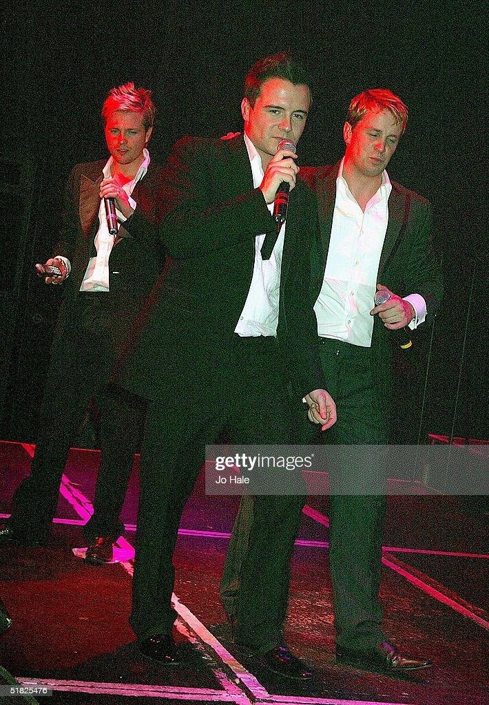 Shane Filan, Kian Egan and Nicky Byrne of Westlife perform