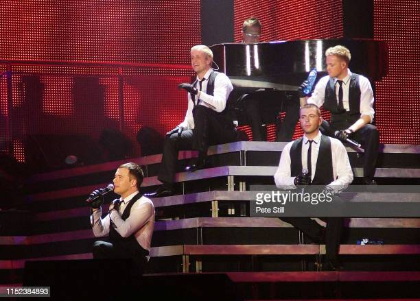 Shane Filan Kian Egan Mark Feehily and Nicky Byrne of Irish boy band Westlife perform on stage at Hammersmith Odeon on March 29th 2008 in London...