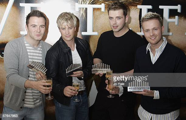 Shane Filan Kian Egan Mark Feehily Nicky Byrne of Westlife pose with their award for the pop act that has performed at one of London's most famous...