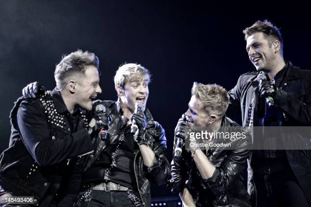 Shane Filan Kian Egan Nicky Byrne and Mark Feehily of Westlife performs on stage at the O2 Arena on May 12 2010 in London United Kingdom