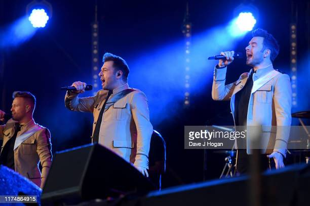 Shane Filan Mark Feehily and Nicky Byrne of Westlife perform on stage during BBC2 Radio Live 2019 at Hyde Park on September 15 2019 in London England