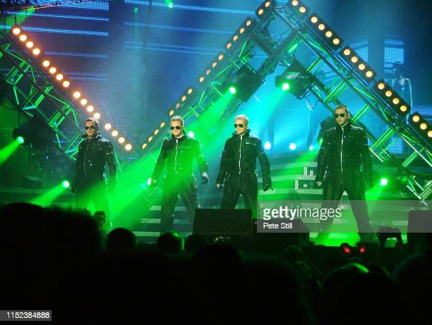 Shane Filan Nicky Byrne Kian Egan and Mark Feehily of Irish boy band Westlife perform on stage at Hammersmith Odeon on March 29th 2008 in London...