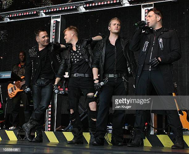 Shane Filan, Nicky Byrne, Kian Egan and Mark Feehily of Westlife perform at Newbury racecourse on August 14, 2010 in Newbury, England
