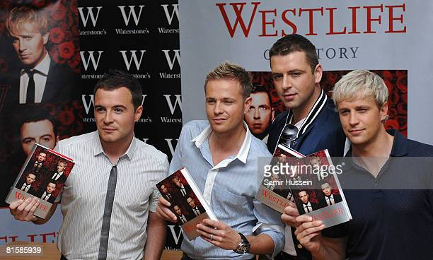 Shane Filan Nicky Byrne Mark Feehily and Kian Egan of Westlife pose at a signing session for their new book 'Westlife' at Waterstone's on June 16...