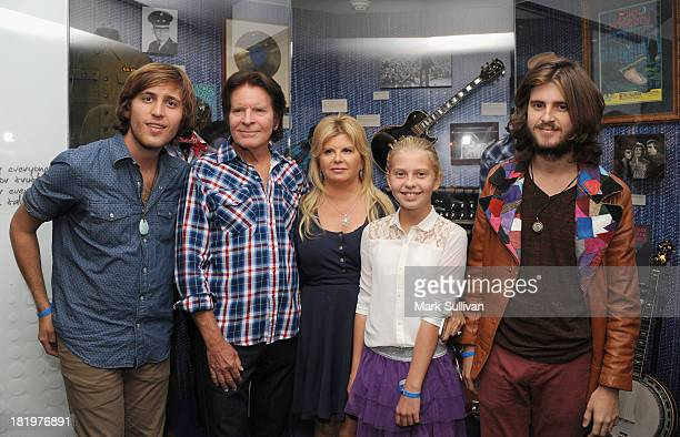 Shane Fogerty John Fogerty Julie Fogerty Kelsy Fogerty and Tyler Fogerty pose in the John Fogerty Wrote A Song For Everyone exhibit during a press...