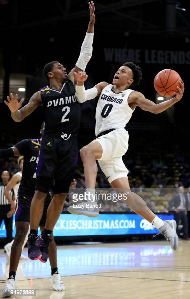 Shane Gatling of the Colorado Buffaloes scores past the defense of Darius Williams of the Prairie View AM Panthers during the second half of a game...