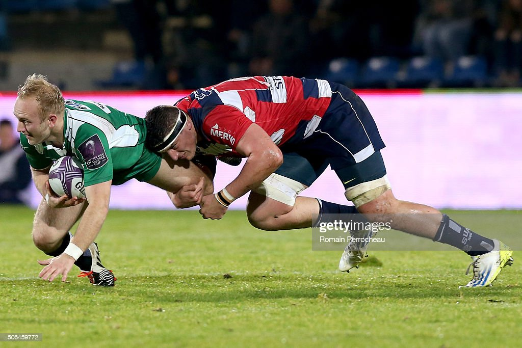 Shane Geraghty for London Irish is tackled by Denis Marchois for Agen during the European Rugby Challenge Cup match between Agen and London rish at stade Armandie on January 23, 2016 in Agen, France.