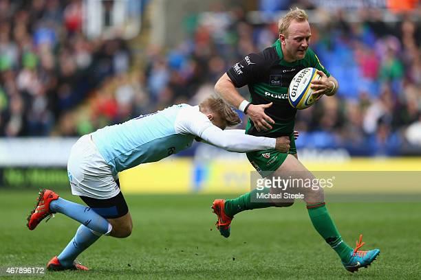 Shane Geraghty of London Irish his challenged by Chris Harris of Newcastle Falcons during the Aviva Premiership match between London Irish and...