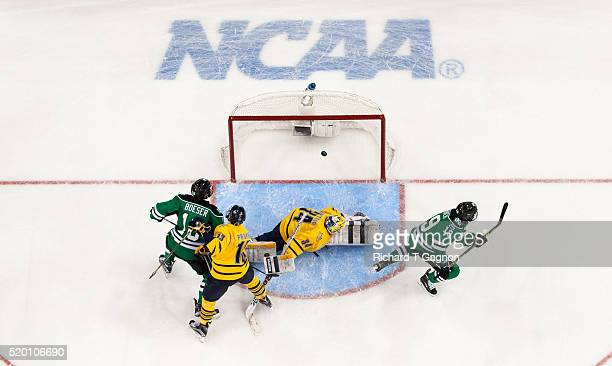 Shane Gersich of North Dakota Fighting Hawks scores a goal against Michael Garteig of the Quinnipiac University Bobcats for a 10 lead during the 2016...