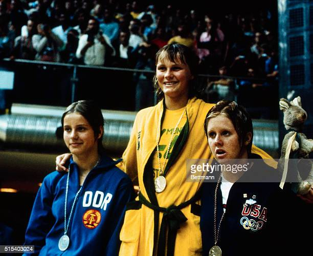 Shane Gould wears the gold medal she won for her world record win in the 200 meter women's medley With her are Kornelia Ender of East Germany silver...