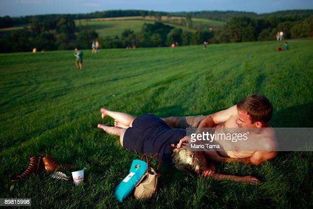 Shane Gray and Bonnie Ba relax during the concert marking the 40th anniversary of the Woodstock music festival August 15 2009 in Bethel New York On...