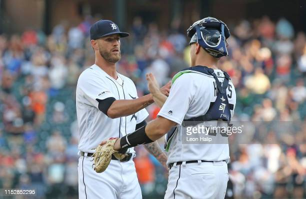 Shane Greene and catcher John Hicks of the Detroit Tigers celebrate a win over the Washington Nationals at Comerica Park on June 29 2019 in Detroit...