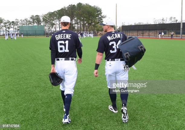 Shane Greene and James McCann of the Detroit Tigers walk together during Spring Training workouts at the TigerTown Facility on February 14 2018 in...