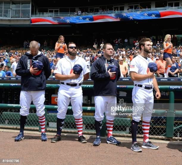 Shane Greene Michael Fulmer Alex Wilson and Daniel Norris of the Detroit Tigers stand together for the National Anthem while wearing red white and...