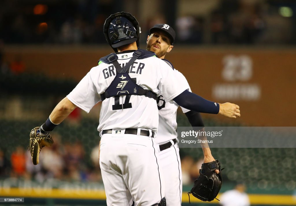 Shane Greene #61 of the Detroit Tigers celebrates a 5-2 win over the Minnesota Twins with Grayson Greiner #17 at Comerica Park on June 13, 2018 in Detroit, Michigan.