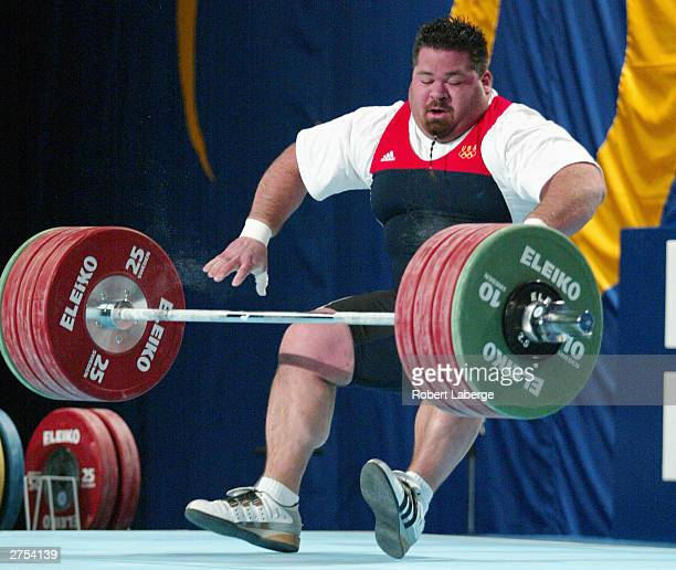 Shane Hamman of the USA falls as he fails to lift 200 Kilograms in the Snatch during the Men's 105 KG Group A Final competition at the 2003 World...
