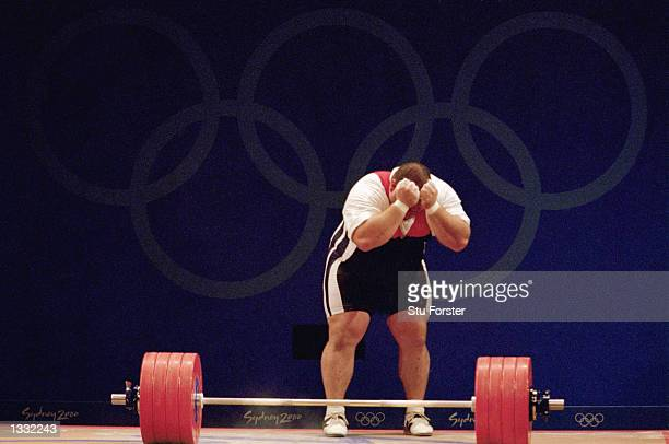 Shane Hamman of the USA reacts after lowering the bar during the Men's 105kg weight lifting finals at the Sydney Convention Centre during the Sydney...