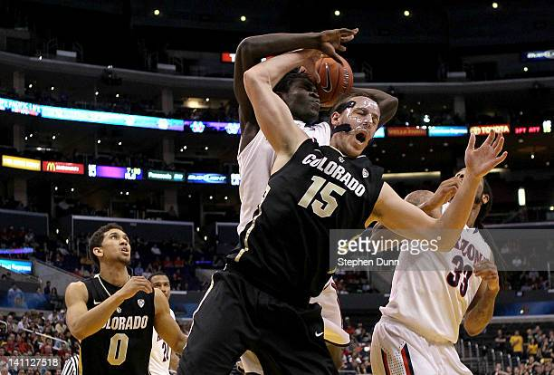 Shane HarrisTunks of the Colorado Buffaloes attempts to grab a rebound in front of Angelo Chol of the Arizona Wildcats in the second half in the...