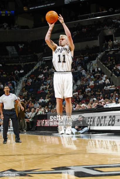 Shane Heal of the San Antonio Spurs shoots a jump shot against the Houston Rockets during the preseason game at the SBC Center on October 24 2003 in...