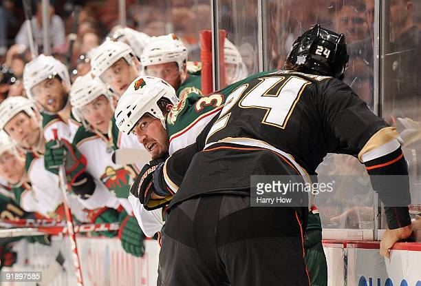 Shane Hnidy of the Minnesota Wild gets into a fight with Evgeny Artyukhin of the Anaheim Ducks during the first period at the Honda Center on October...
