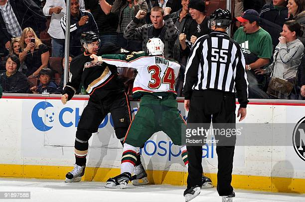 Shane Hnidy of the Minnesota Wild scraps with Evgeny Artyukhin of the Anaheim Ducks alongside the boards during the game on October 14 2009 at Honda...