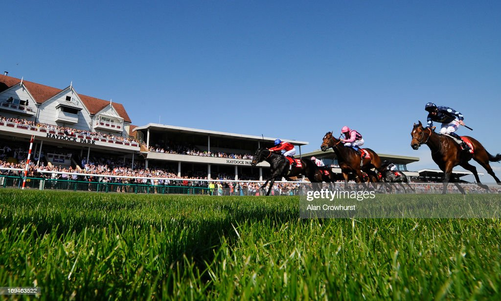 Shane Kelly riding Kingsgate Native (L, red) win The Betfred Temple Stakes at Haydock racecourse on May 25, 2013 in Haydock, England.