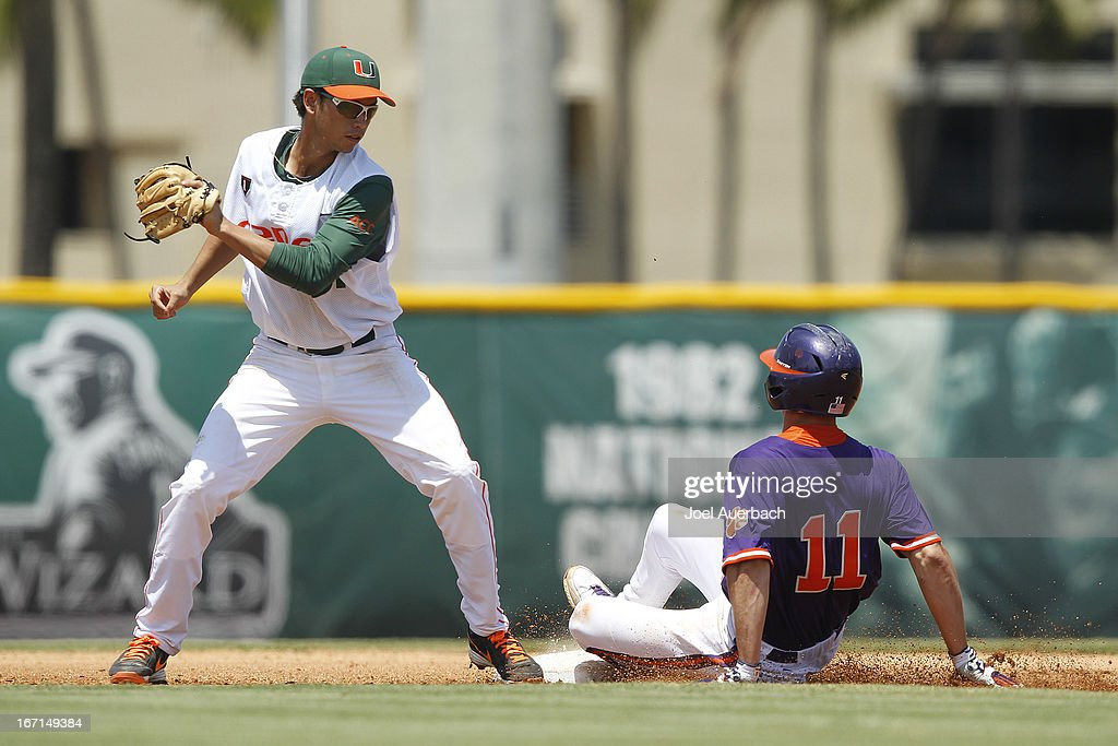 Shane Kennedy #11 of the Clemson Tigers steals second base ahead of the tag by Brandon Lopez #51 of the Miami Hurricanes on April 21, 2013 at Alex Rodriguez Park at Mark Light Field in Coral Gables, Florida. Miami defeated Clemson 7-0.