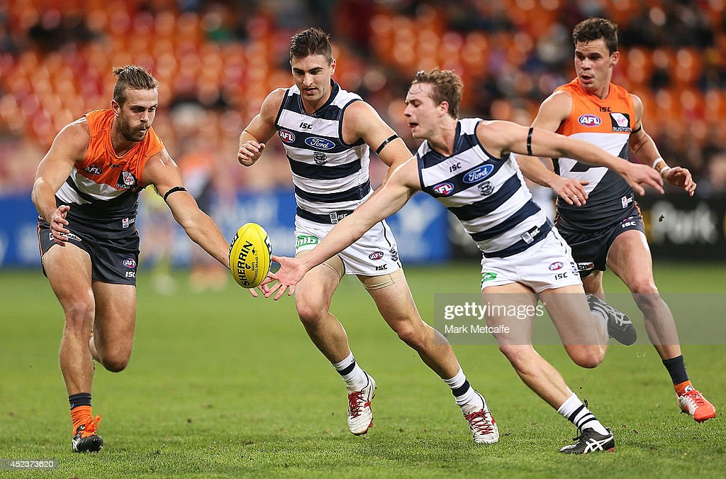 Shane Kersten of the Cats competes for the ball against Tim Mohr of the Giants during the round 18 AFL match between the Greater Western Sydney Giants and the Geelong Cats at Spotless Stadium on July 19, 2014 in Sydney, Australia.