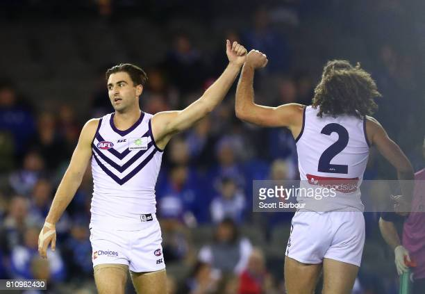 Shane Kersten of the Dockers is congratulated by his teammates after kicking a goal during the round 16 AFL match between the North Melbourne...