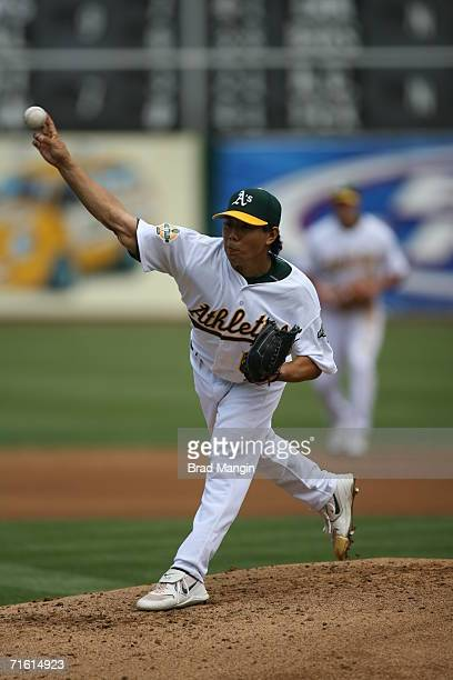 Shane Komine of the Oakland Athletics pitches during the game against the Toronto Blue Jays at the Network Associates Coliseum in Oakland California...