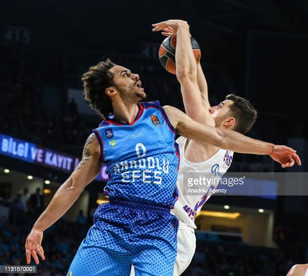 Shane Larkin of Anadolu Efes in action against Alec Peters of CSKA Moscow during the Turkish Airlines Euroleague week 27 basketball match between...