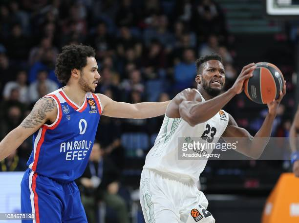 Shane Larkin of Anadolu Efes in action against Toney Douglas of Darussafaka Tekfen during Turkish Airlines Euroleague basketball match between...