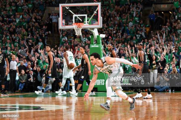 Shane Larkin of the Boston Celtics celebrates hitting a three point buzzer beater to end the third quarter against the Milwaukee Bucks in Game Two of...