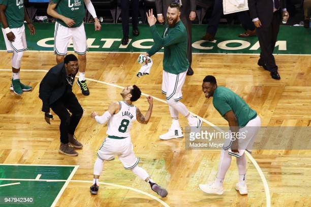 Shane Larkin of the Boston Celtics celebrates with Marcus Smart Aron Baynes and Guerschon Yabusele after hitting a three point shot against the...