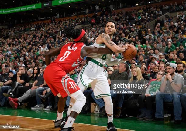 Shane Larkin of the Boston Celtics handles the ball against Briante Weber of the Houston Rockets on December 28 2017 at the TD Garden in Boston...