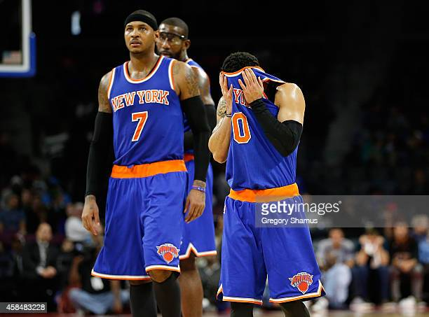 Shane Larkin of the New York Knicks reacts after a late fourth quarter turnover next to Carmelo Anthony while playing the Detroit Pistons at the...