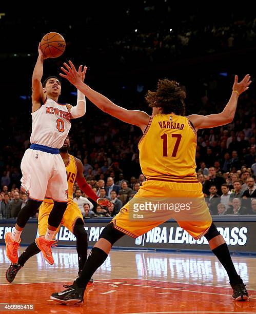 Shane Larkin of the New York Knicks tries to take a shot in the final minute of the game as Anderson Varejao of the Cleveland Cavaliers defends at...