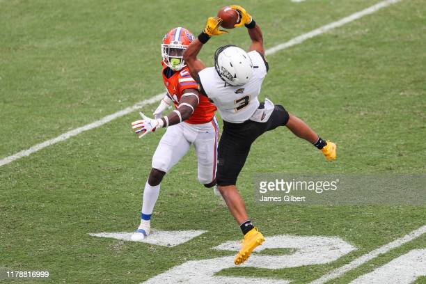 Shane Leatherbury of the Towson Tigers catches a pass against Trey Dean III of the Florida Gators during the third quarter of a game at Ben Hill...