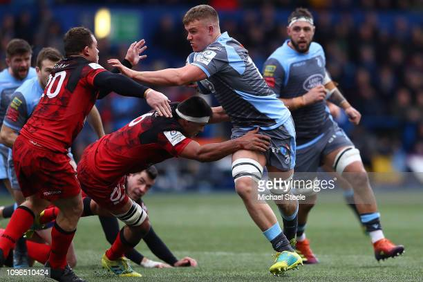 Shane LewisHughes of Cardiff runs at Dylan Cretin and Dean Fourie of Lyon during the Champions Cup Pool 3 match between Cardiff Blues and Lyon...
