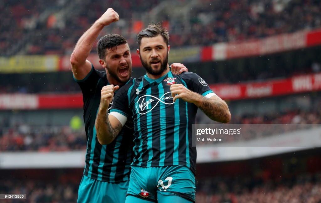 Shane Long (L) and Charlie Austin of Southampton during the Premier League match between Arsenal and Southampton at Emirates Stadium on April 8, 2018 in London, England.