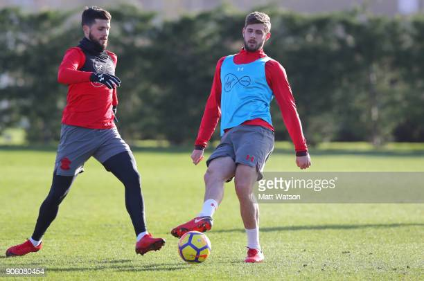 Shane Long and Jack Stephens of Southampton FC during a training session at the Staplewood Campus on January 17 2018 in Southampton England