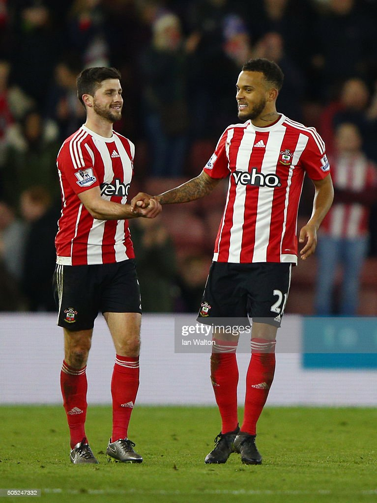 Shane Long (L) and Ryan Bertrand (R) of Southampton shake hands after their 3-0 win in the Barclays Premier League match between Southampton and West Bromwich Albion at St. Mary's Stadium on January 16, 2016 in Southampton, England.