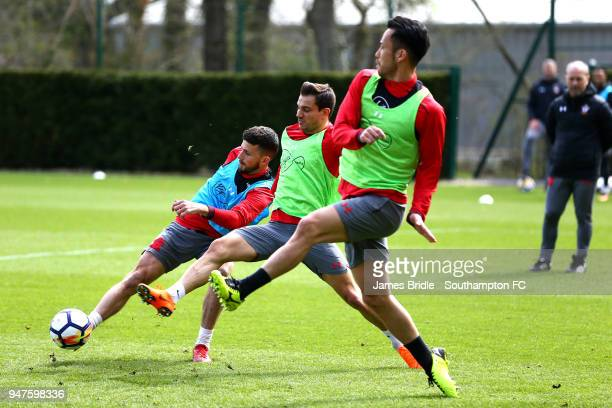 Shane Long Cedric and Maya Yoshida in action during a Southampton FC training session at Staplewood Complex on April 17 2018 in Southampton England