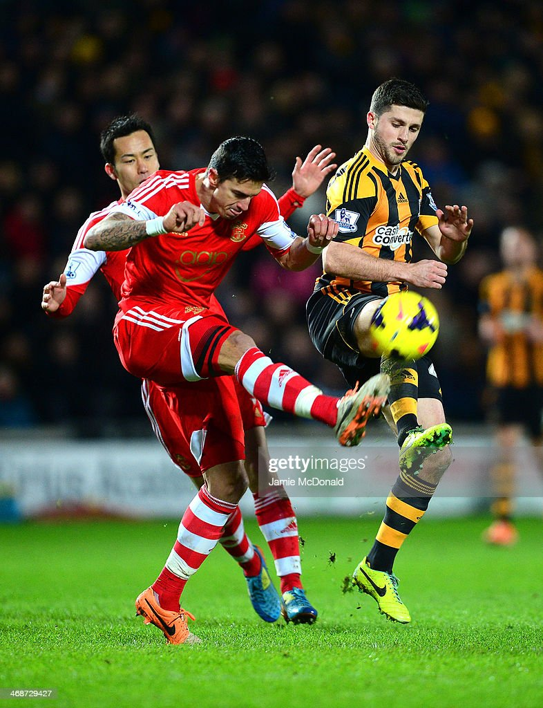 Shane Long of Hull City and Jose Fonte of Southampton compete for the ball during the Barclays Premier League match between Hull City and Southampton at the KC Stadium on February 11, 2014 in Hull, England.